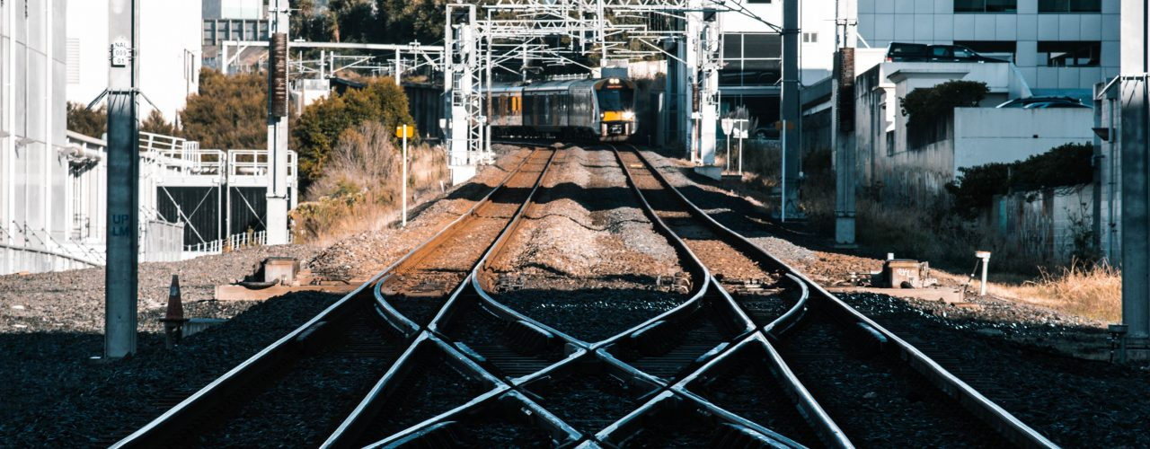 train tracks in the city during daytime