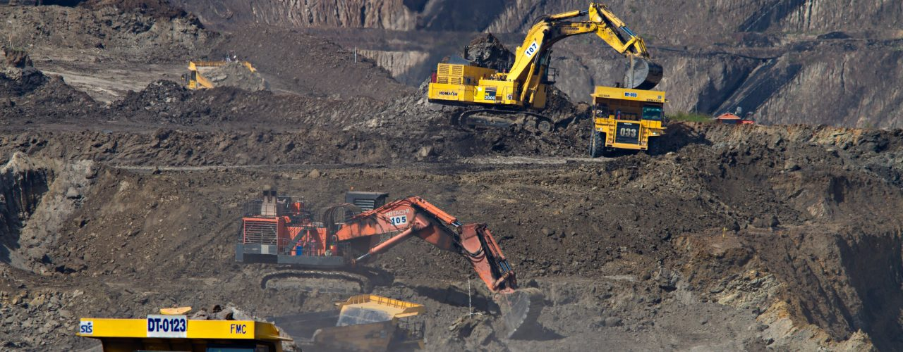 photography of excavators at mining area