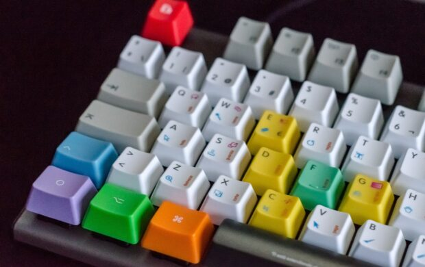 white, orange, green, and purple computer keyboard