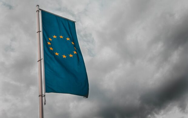 teal flag under cloudy sky