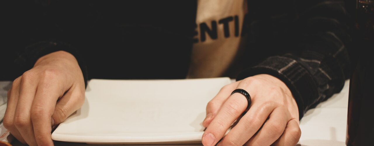 person wearing a black ring