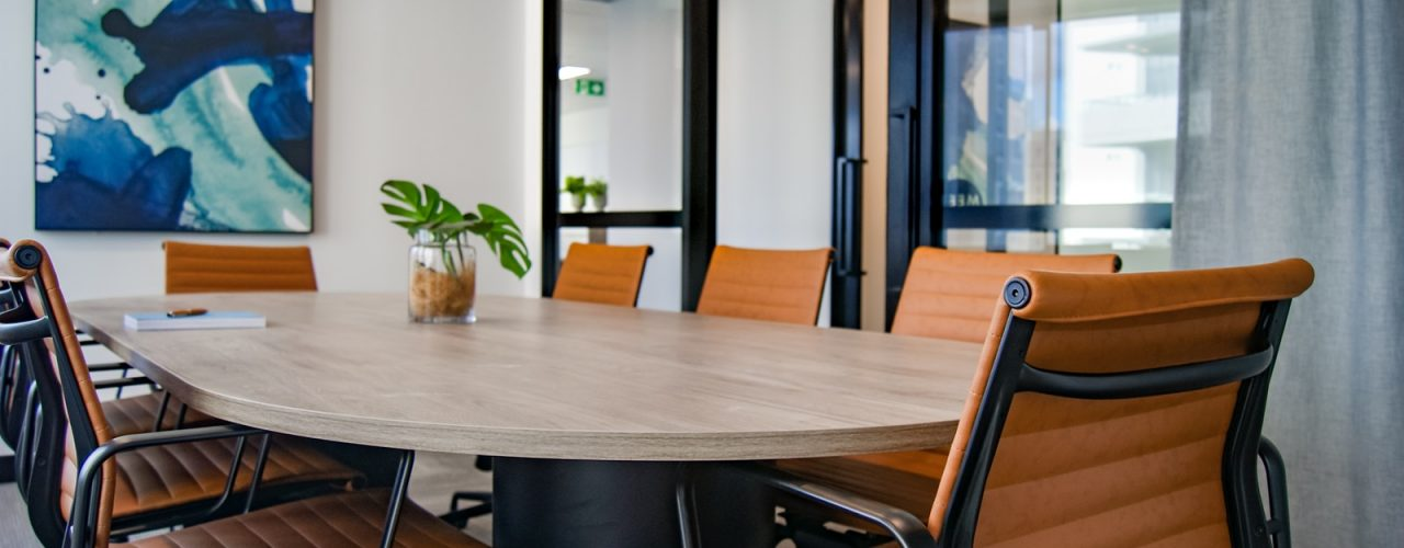 brown wooden 9-piece office table and chairs