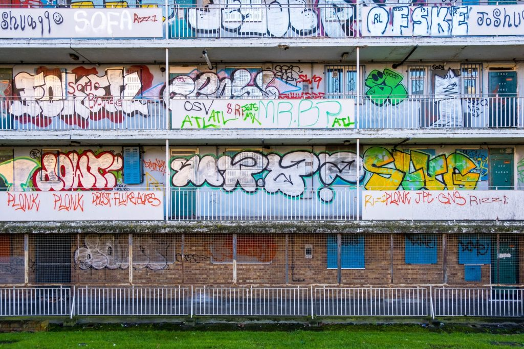 white and blue graffiti on wall