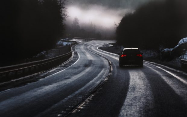 black car on road during foggy weather