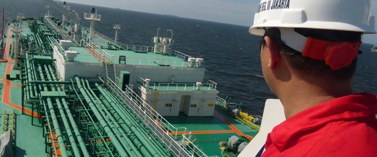 Gas rig and worker at Masela