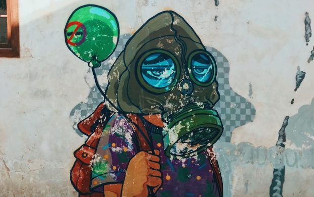 person wearing respirator mural
